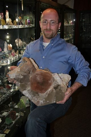 Dr. Robert Lavinsky with the Magic Mirror Morganite from Afghanistan, a significant piece of natural history.