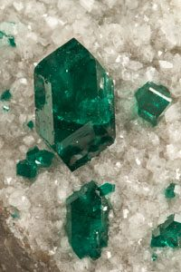 This fine dioptase is an example of a fine mineral from the Tsumeb Mine in Namibia. TsumebFineMinerals.com is a recommended site to learn more about this incredible mine.