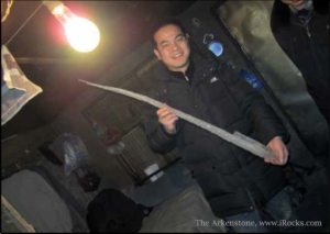 The Arkenstone employee Chen Xiaojun plays with a meter-long icicle in Chifeng while hnting for fine mineral specimens.