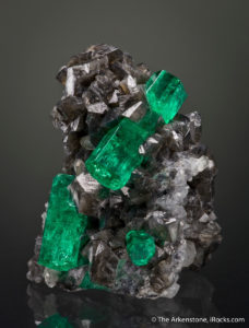 Beryl var. Emerald from Coscuez Mine, Colombia. Photo by Joe Budd, courtesy of The Arkenstone, www.iRocks.com