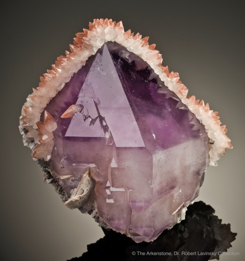 An amethyst crystal with a crown of tiny calcites
