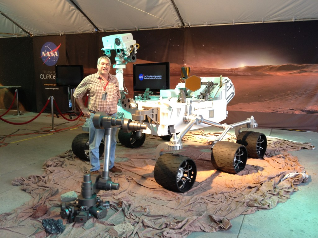 Dr. Robert Downs and the Curiosity Rover, which launched from Earth in 2011 and landed on Mars in 2012.
