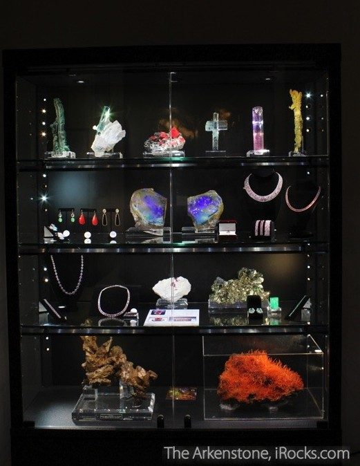 A spectacular case of fine minerals, gems, and jewelry from The Arkenstone at a private gallery show.