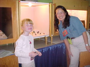 "A young Lauren Megaw with her ""Aunt"" Mary Fong-Walker setting up her mineral case"