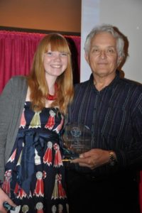 Les Presmyk presents Lauren Megaw with the Desautels Award