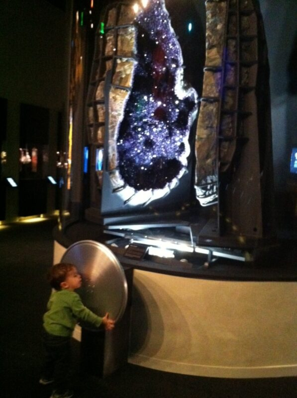 Boy with amethyst geode at Perot Museum