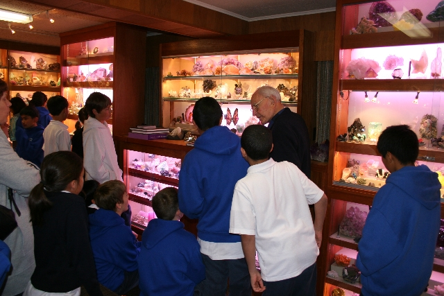 Jack Halpern with children in his mineral displays