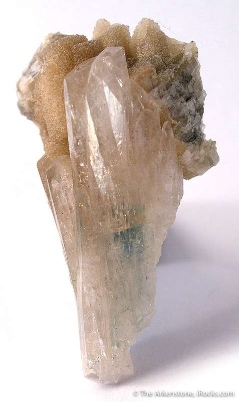 This splayed cluster cream colored lustrous glassy kovdorskite