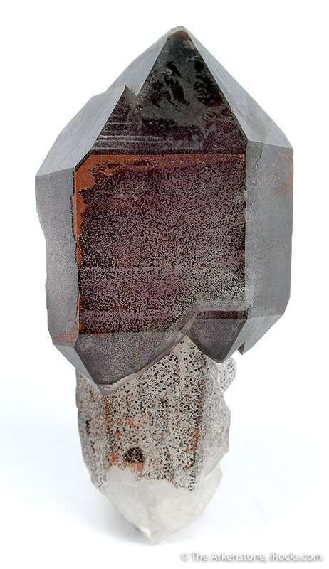 This dramatic sceptered quartz crystal milky stem sprinkled hematite