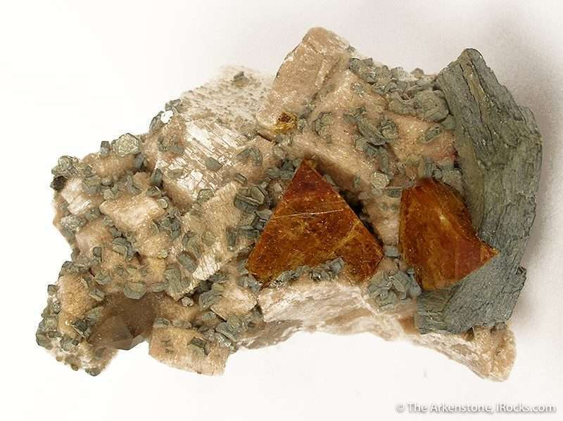 Two extremely sharp colorful crystals perched matrix feldspar dotted