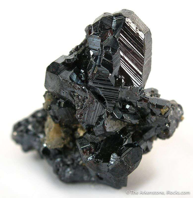 A brilliantly metallic lustrous gemmy crystal 1 cm surmounts matrix