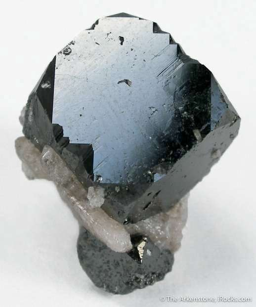 This specimen features equant lustrous sharply formed bixbyite perched