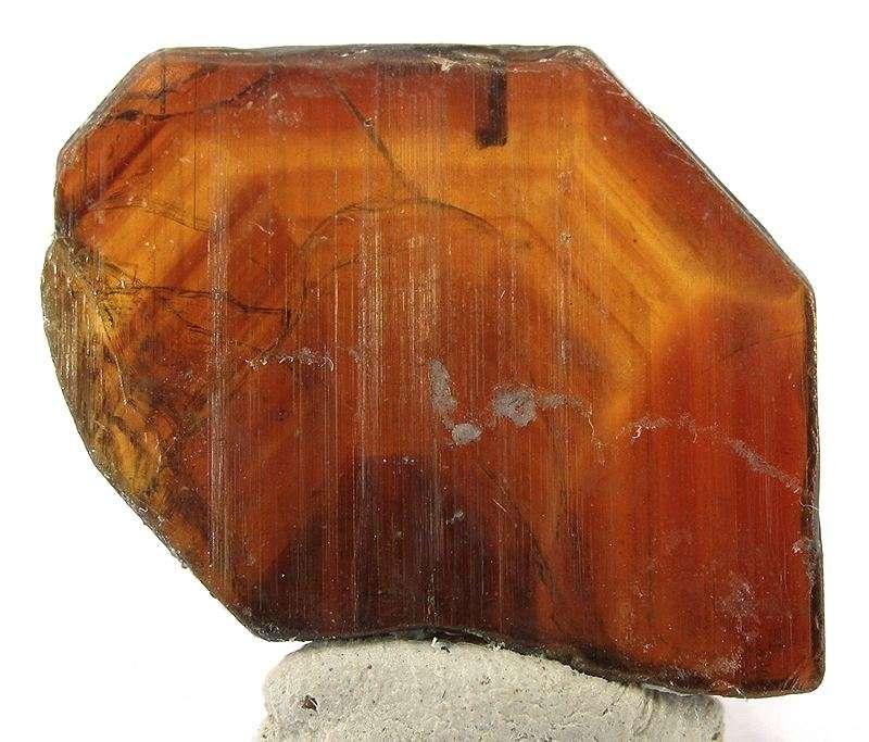 Stibiotantalite uncommon species pegmatite orange red gem crystals