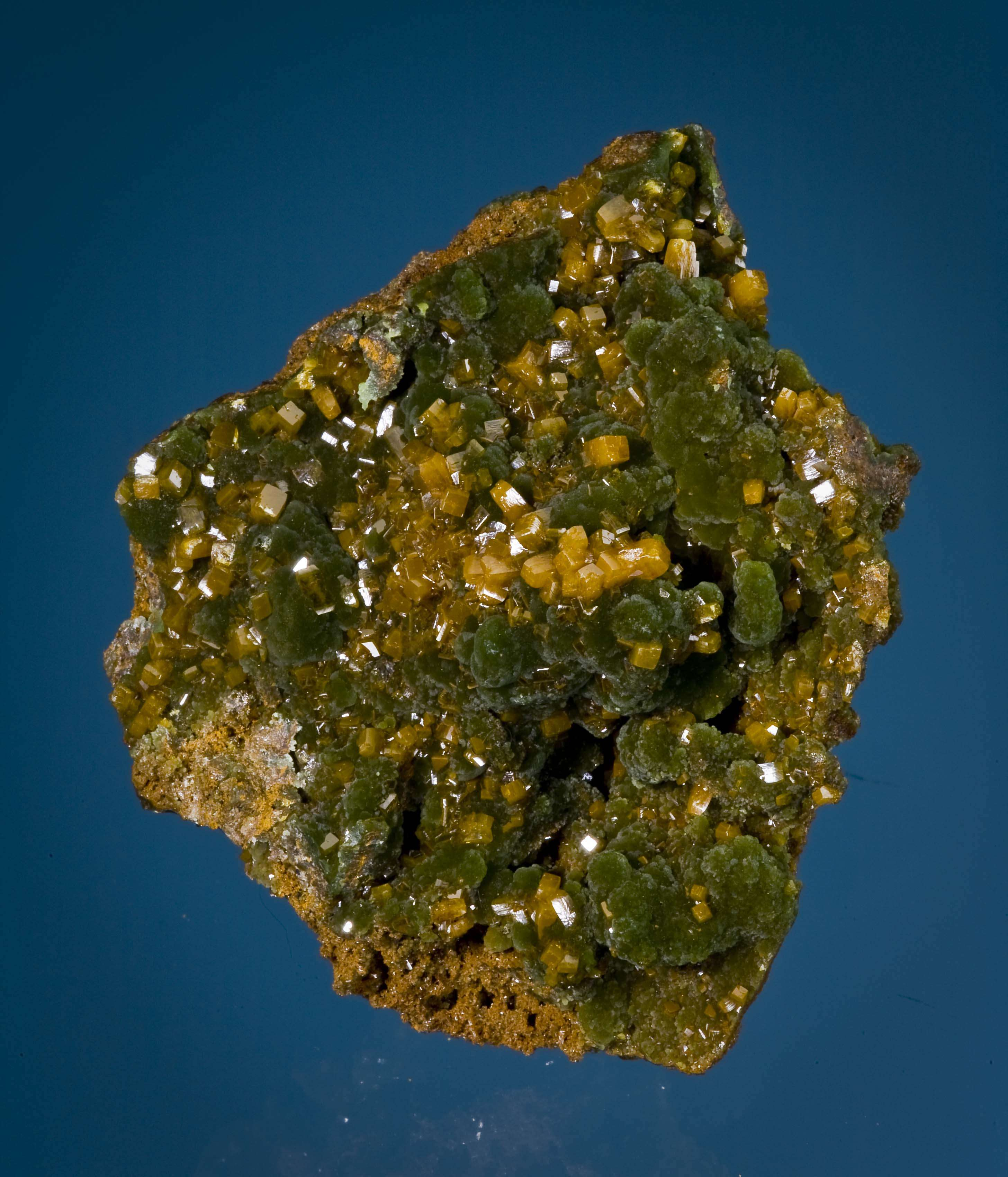 A richly colored specimen thick mimetite covering galena rich