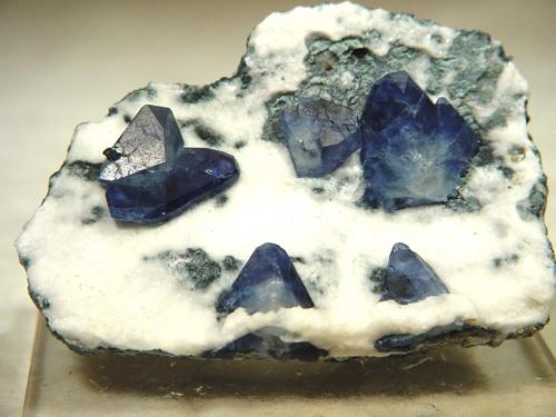 Five fine sharp benitoite crystals nicely balanced matrix partly gemmy