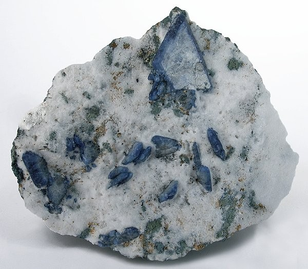 This unusual specimen features flat 2 dimensional benitoite crystals