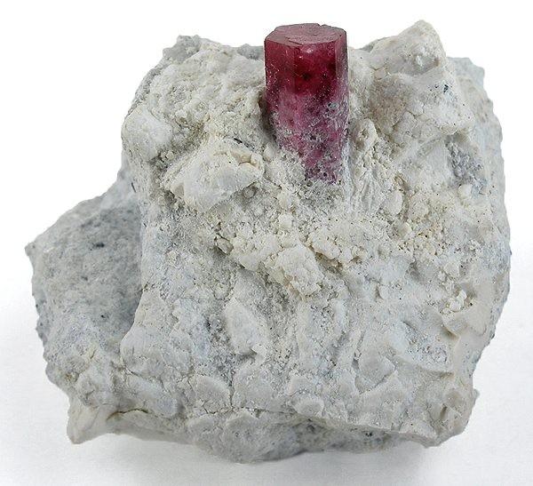 A sharp somewhat translucent 15 x 7 x 7 mm crystal red beryl matrix