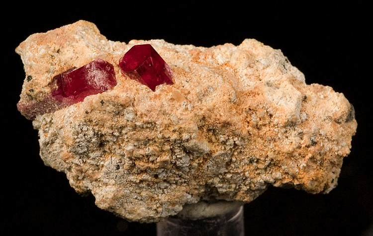 A fine representative thumbnail gemmy lustrous cranberry red beryl