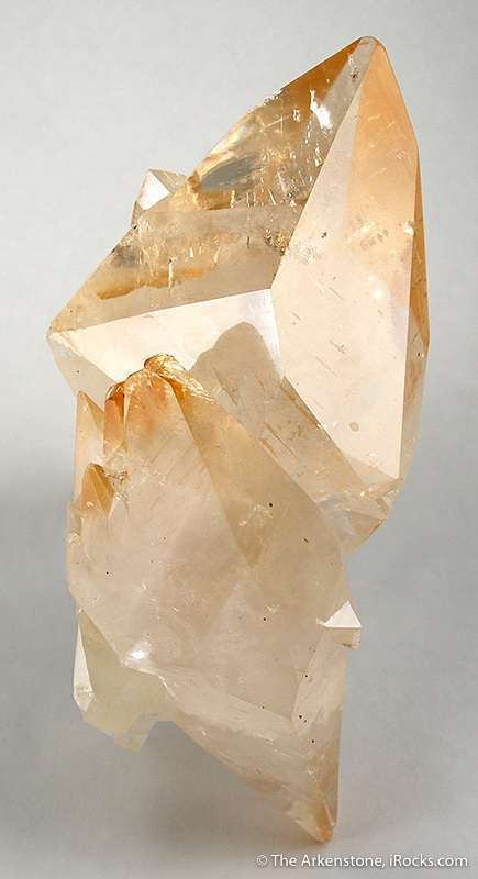 Two large doubly terminated gemmy cognac colored calcite crystals 13