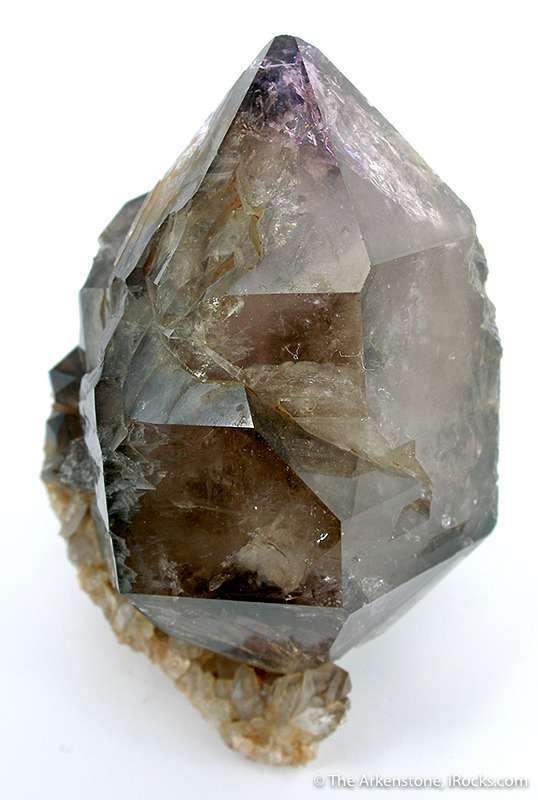 A sharp smoky quartz crystal amethyst highlights antique old Russian