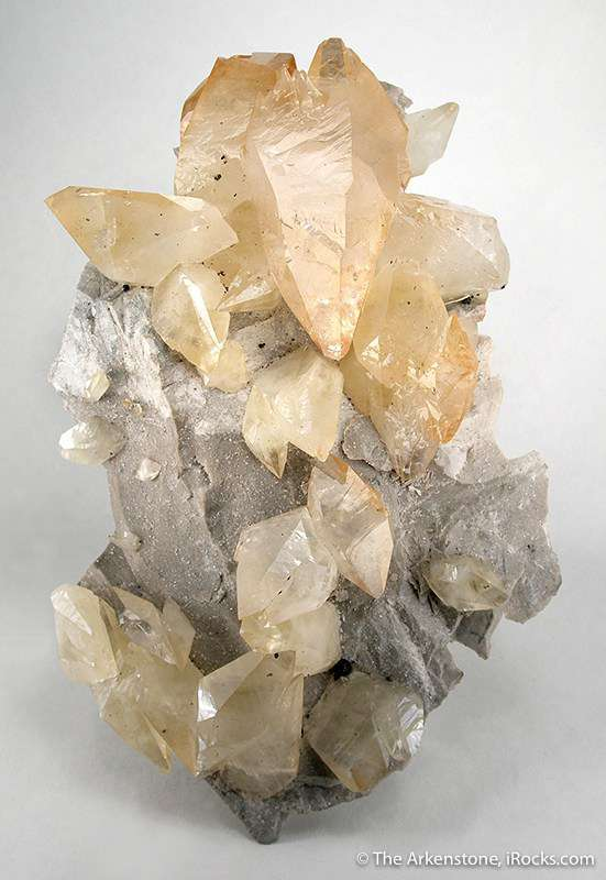 A large plate gray limestone encrusted approximately 25 calcite