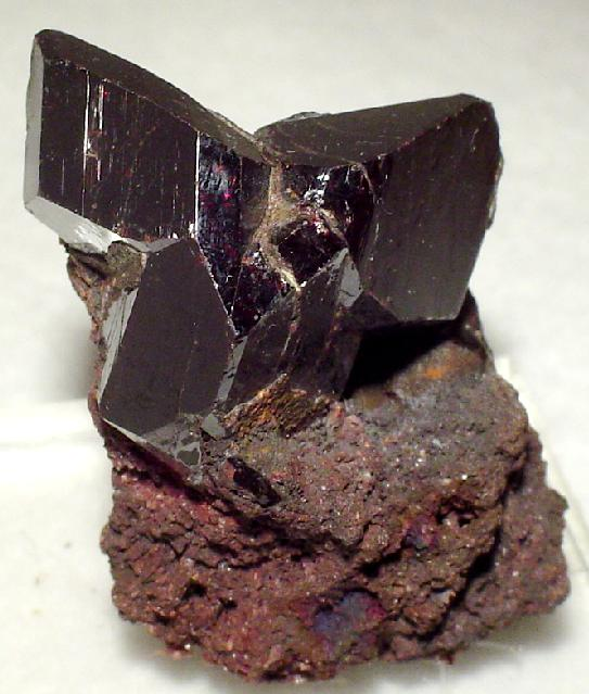 An aesthetic sharp cluster lustrous dark red rutile crystals nicely