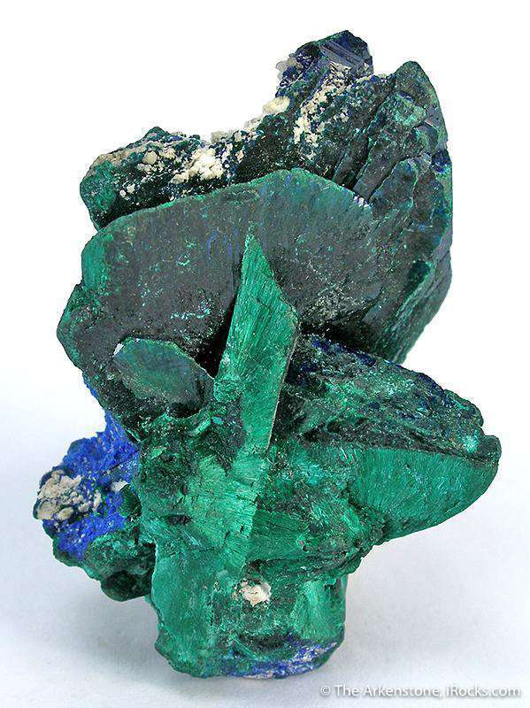A complexly grown cluster blades azurite entirely altered malachite