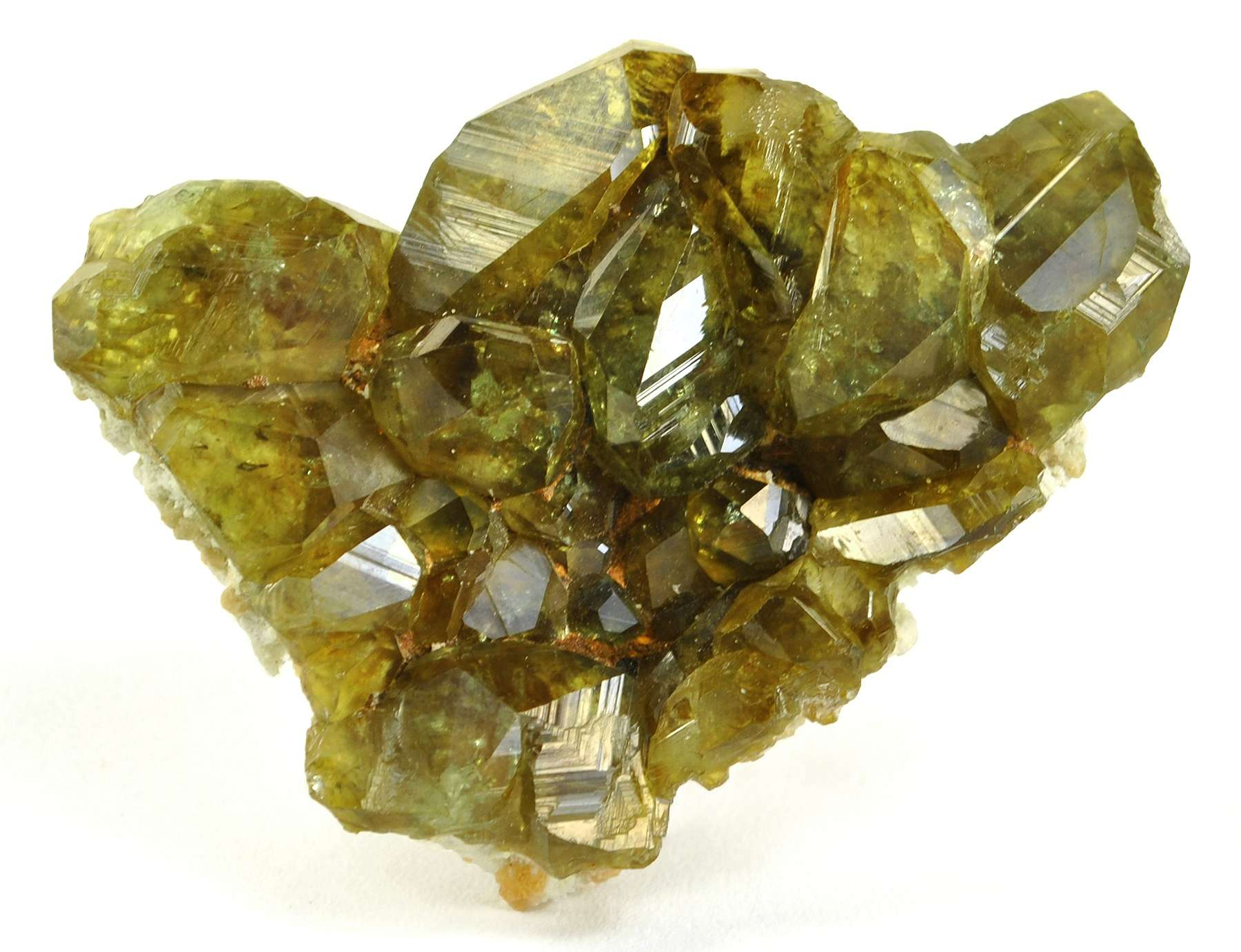 Intergrown crystals glassy gemmy olive green colored demantoid