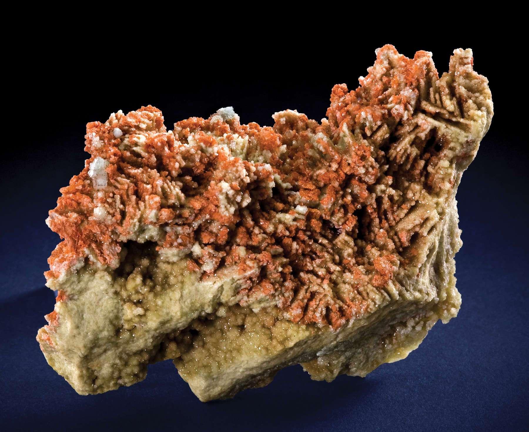 Emplaced vuggy matrix massive boracite druse lustrous salmon colored