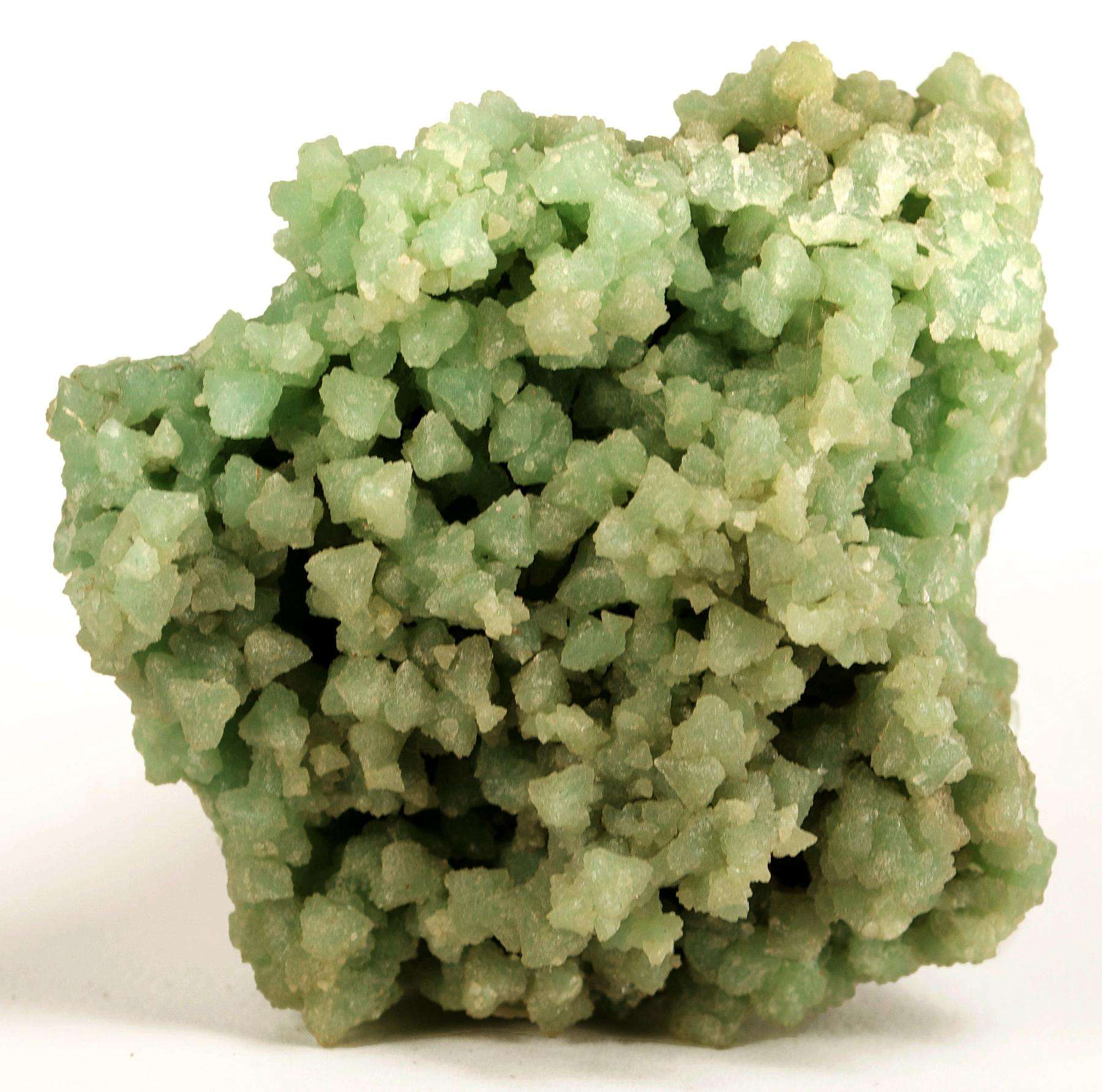 Lustrous frosted light green boracite crystals 5 mm totally comprise