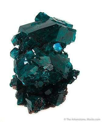 A killer toenail featuring 2 25 x 1 x 1 cm dioptase crystal perched