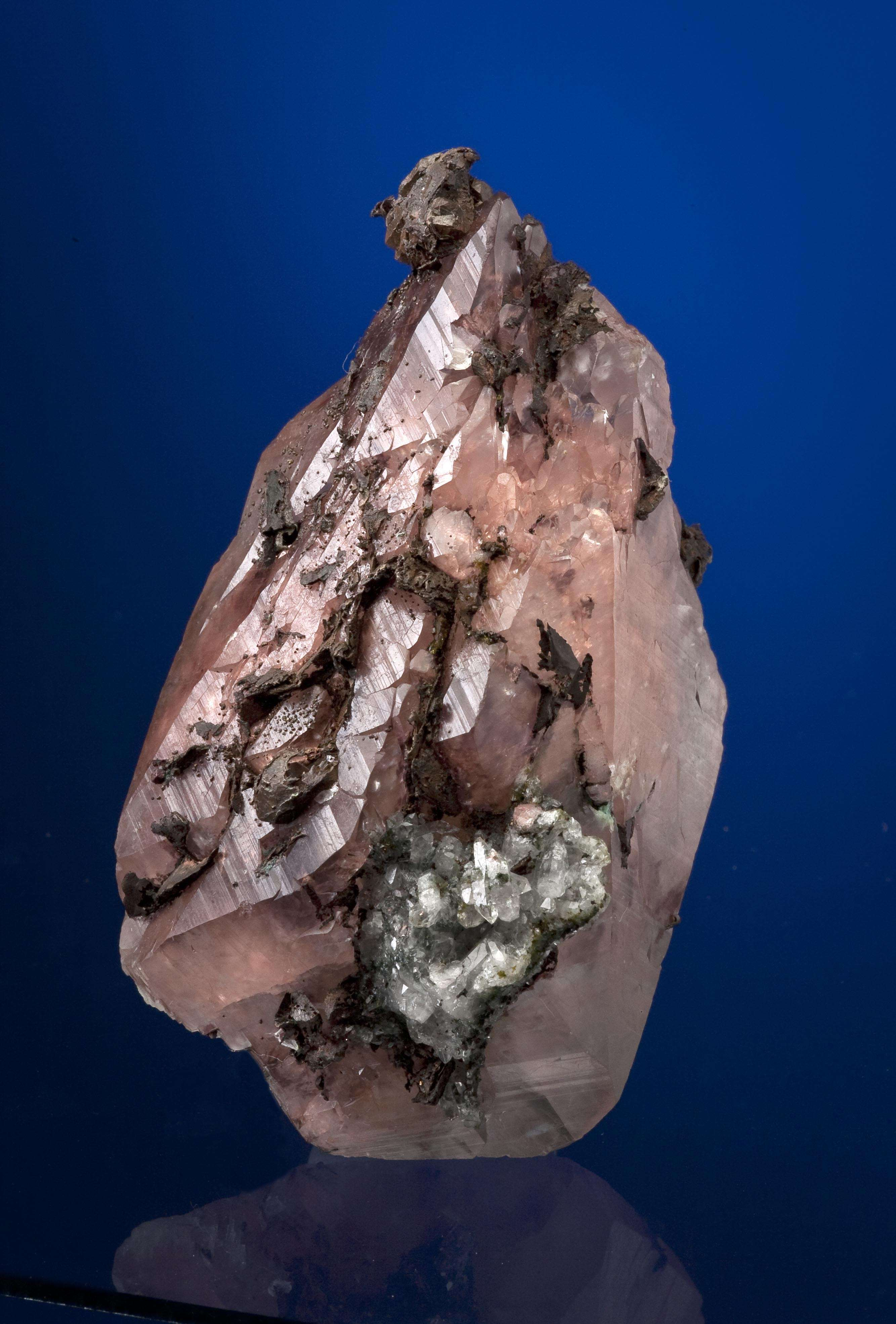 This exceptionally large heavily included calcite crystal minute