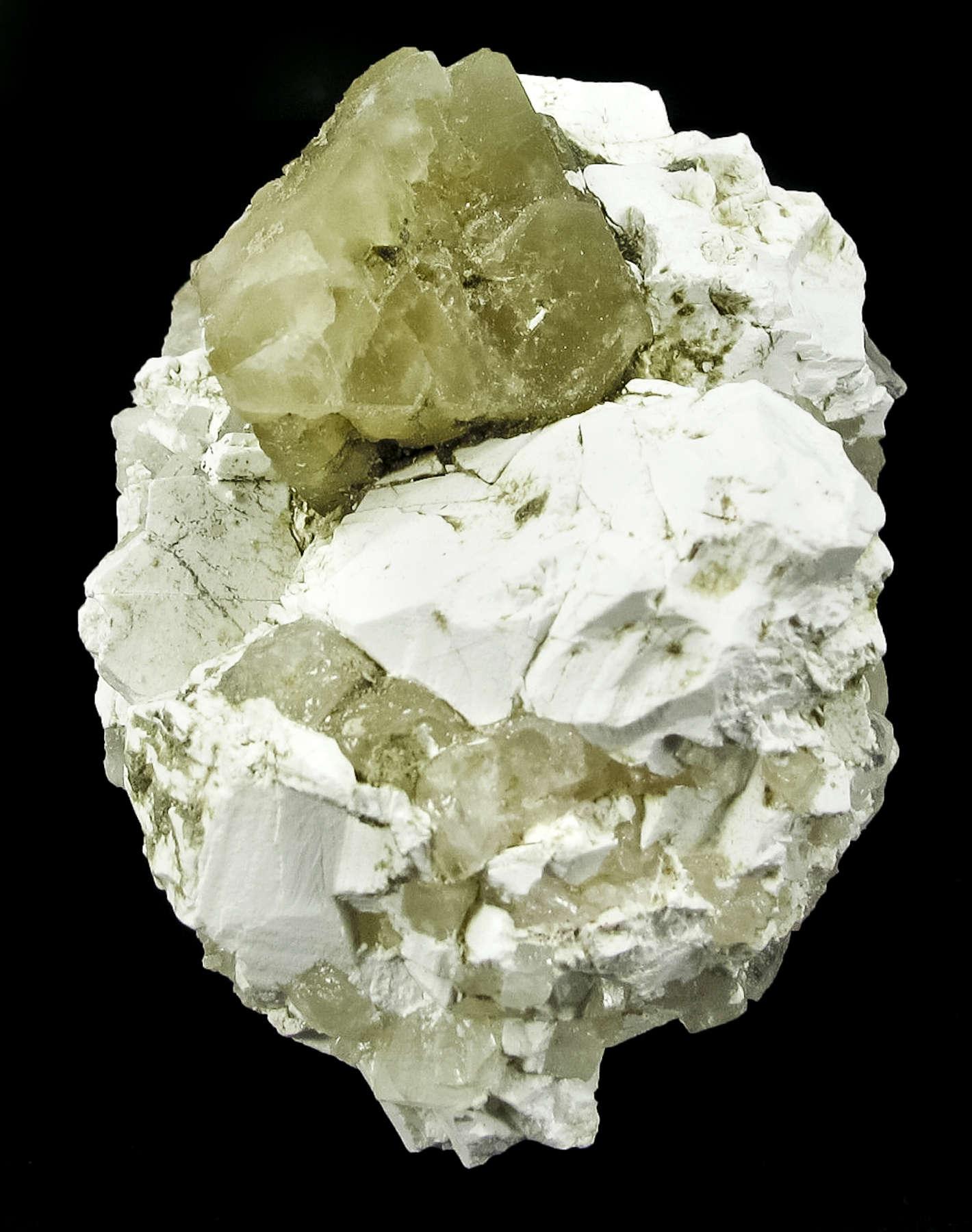 A borax matrix host single octahedron matte luster translucent tan