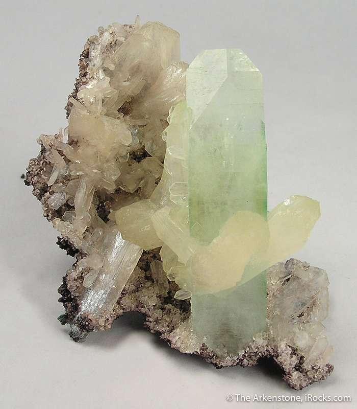 This matrix specimen features pearlescent 3 0 cm stilbite crystals