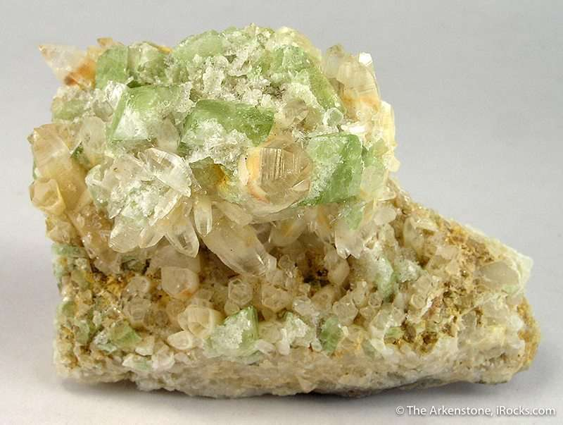 Quartz crystals 2 5 cm length surround green crystals augelite 1 5 cm