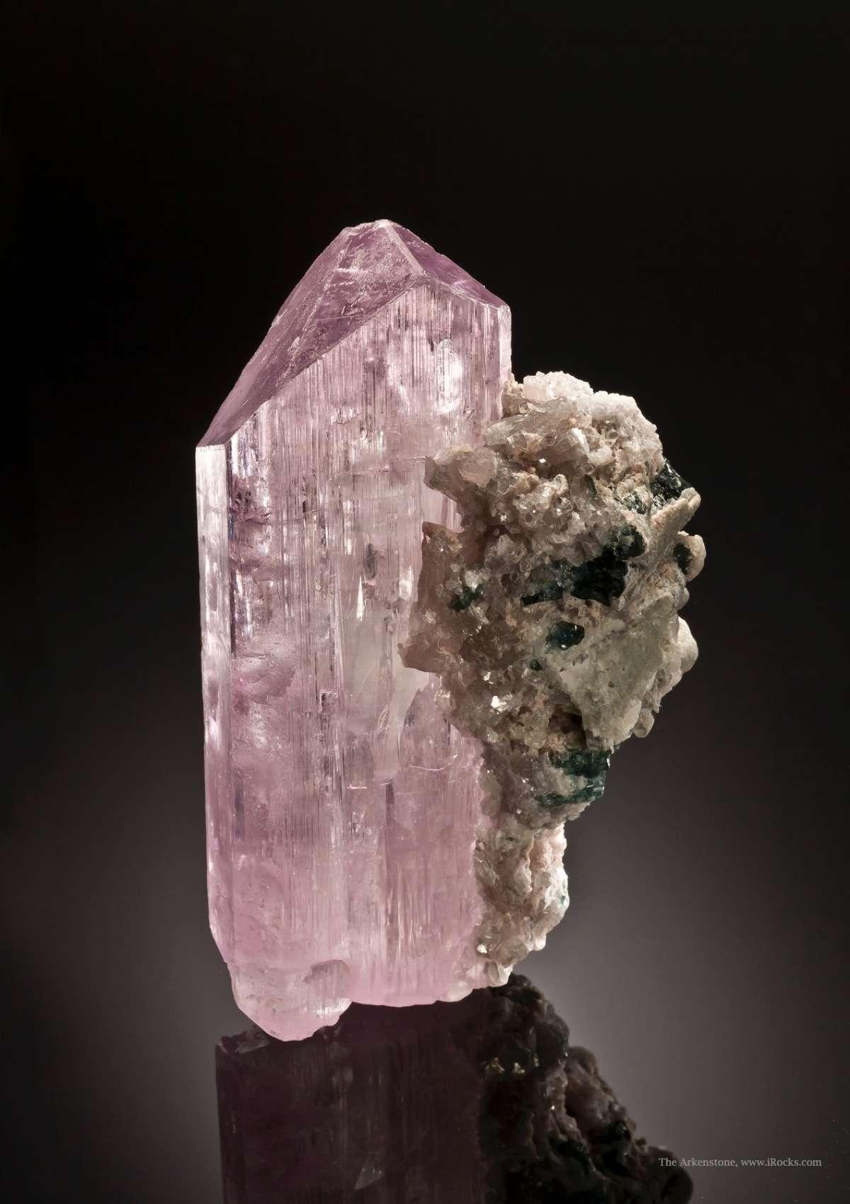 A dramatic kunzite crystal showing unusually fine sharp termination