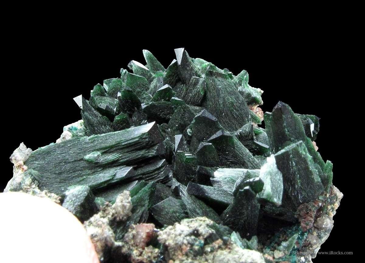 A superb miniature sharp tapered dark green Libethenite crystals range