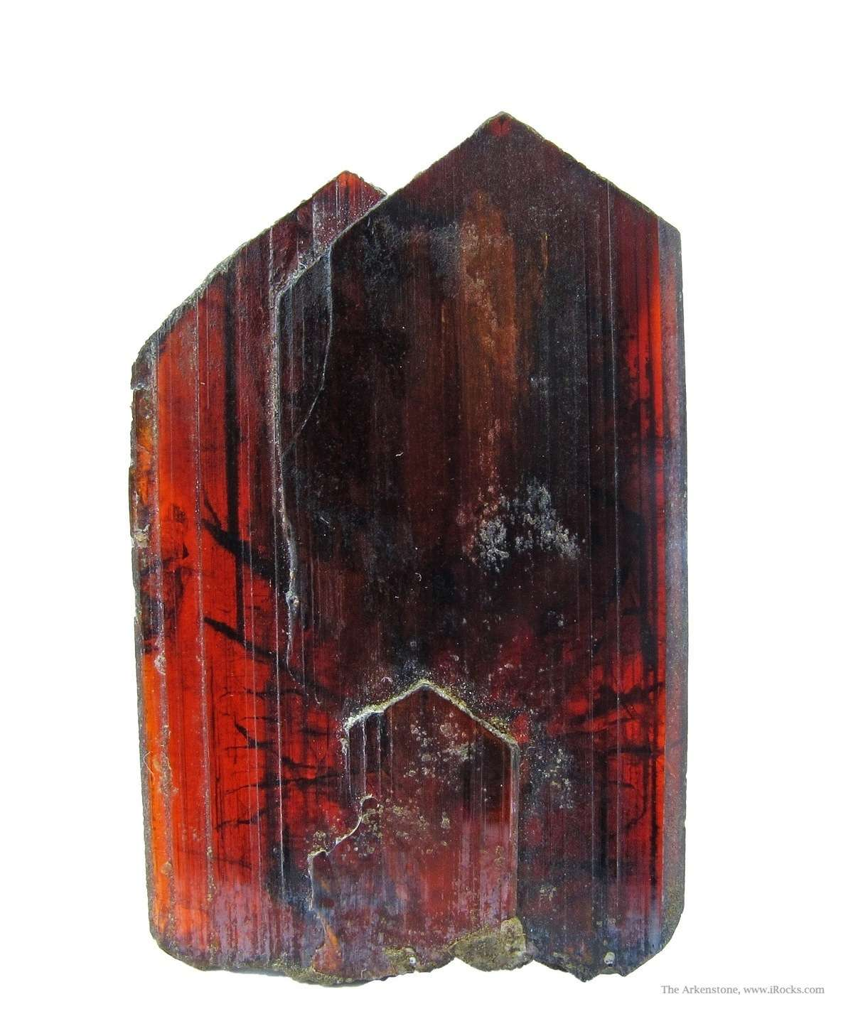 This pair intergrown Brookite blades formed translucent brownish red