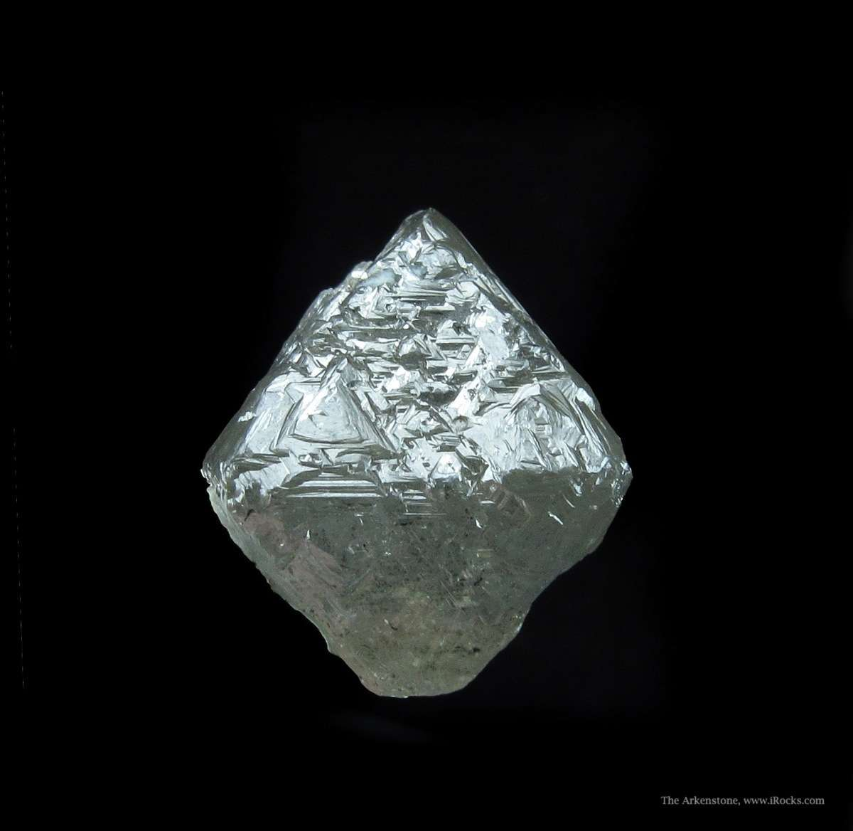An excellent sharp diamond octahedron weighing 19 02 carats The