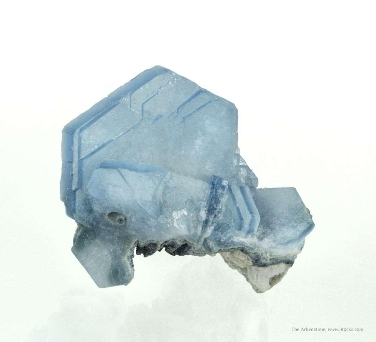 An aesthetic cluster tabular lustrous translucent sky blue cesium rich