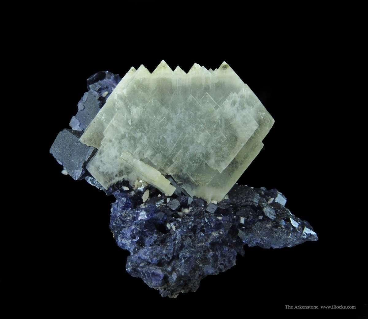 A fine sharp Baryte crystal nestled beautifully base rich purple
