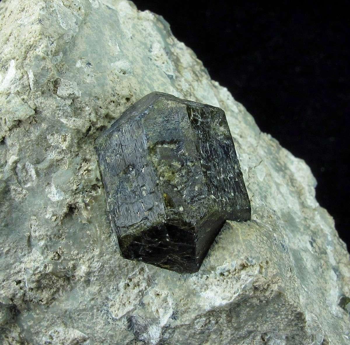 A rare titanium bearing member Vesuvianite group Wiluite worldwide