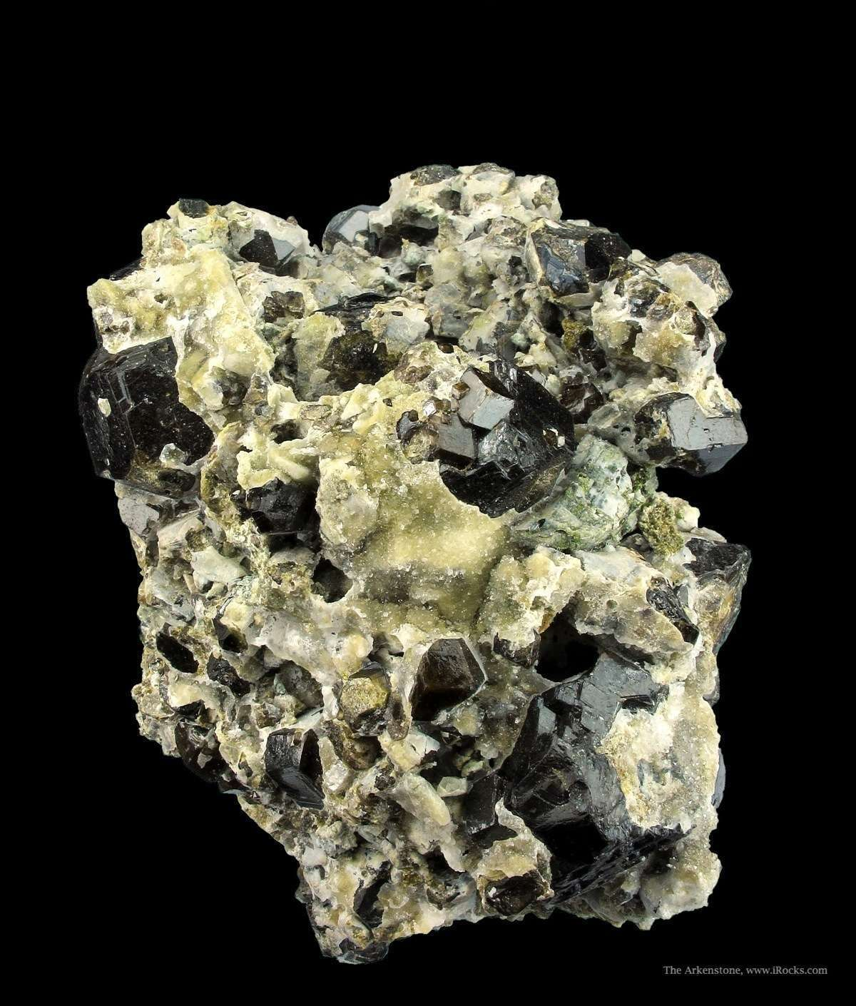 A rare locality piece This hefty cabinet specimen rich Andradites