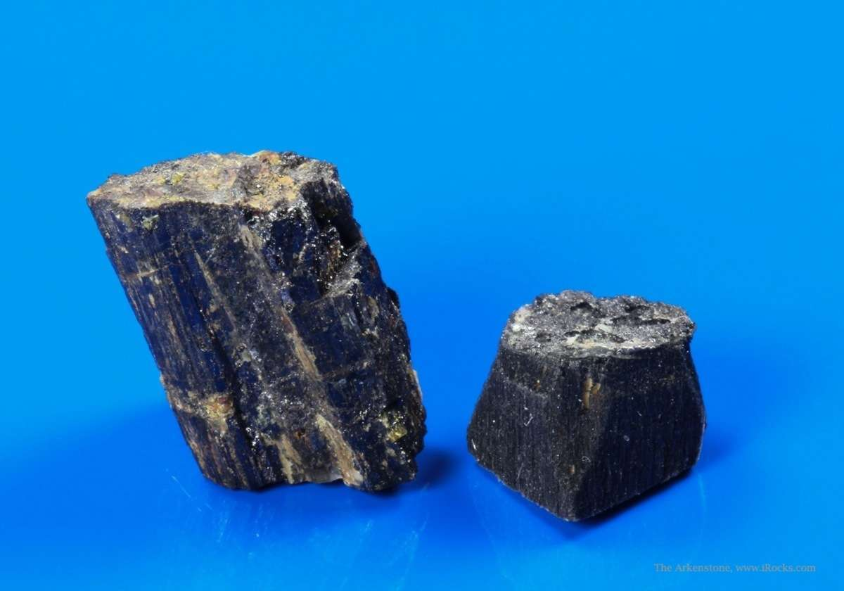 Two nice vitreous vertically striated blackish brown crystal fragments