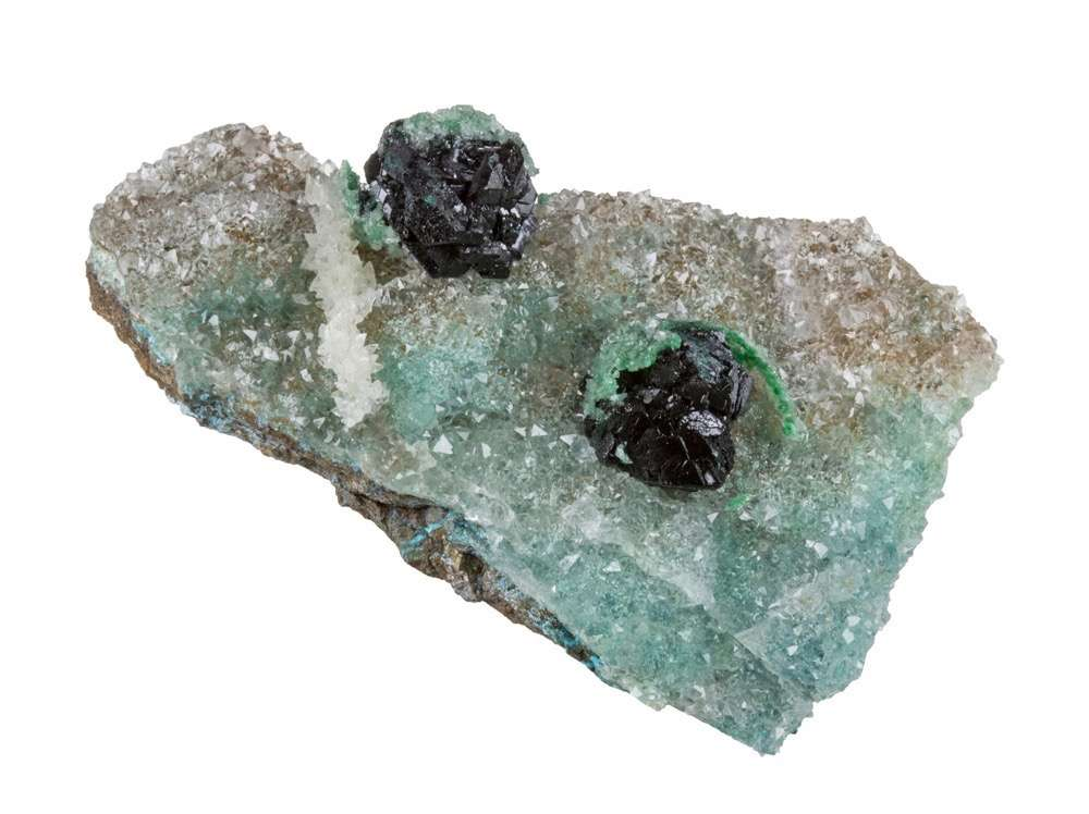 Two equant isolated lustrous blackish green clusters clinoatacamite