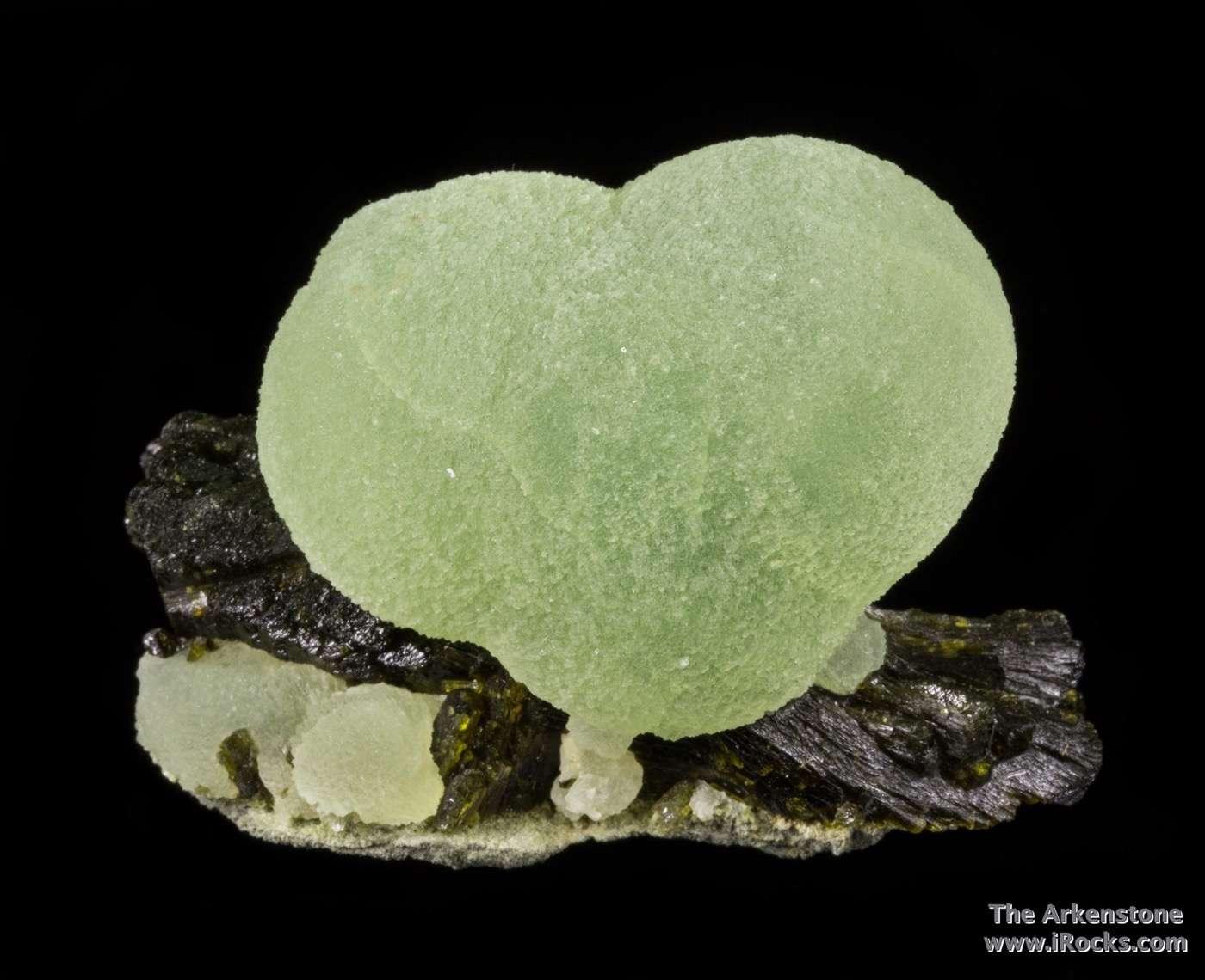 Two intergrown spheres satiny luster translucent apple green prehnite