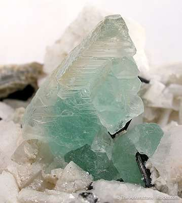 Weird fluorite Aesthetically nestled vug snow white lustrous feldspar