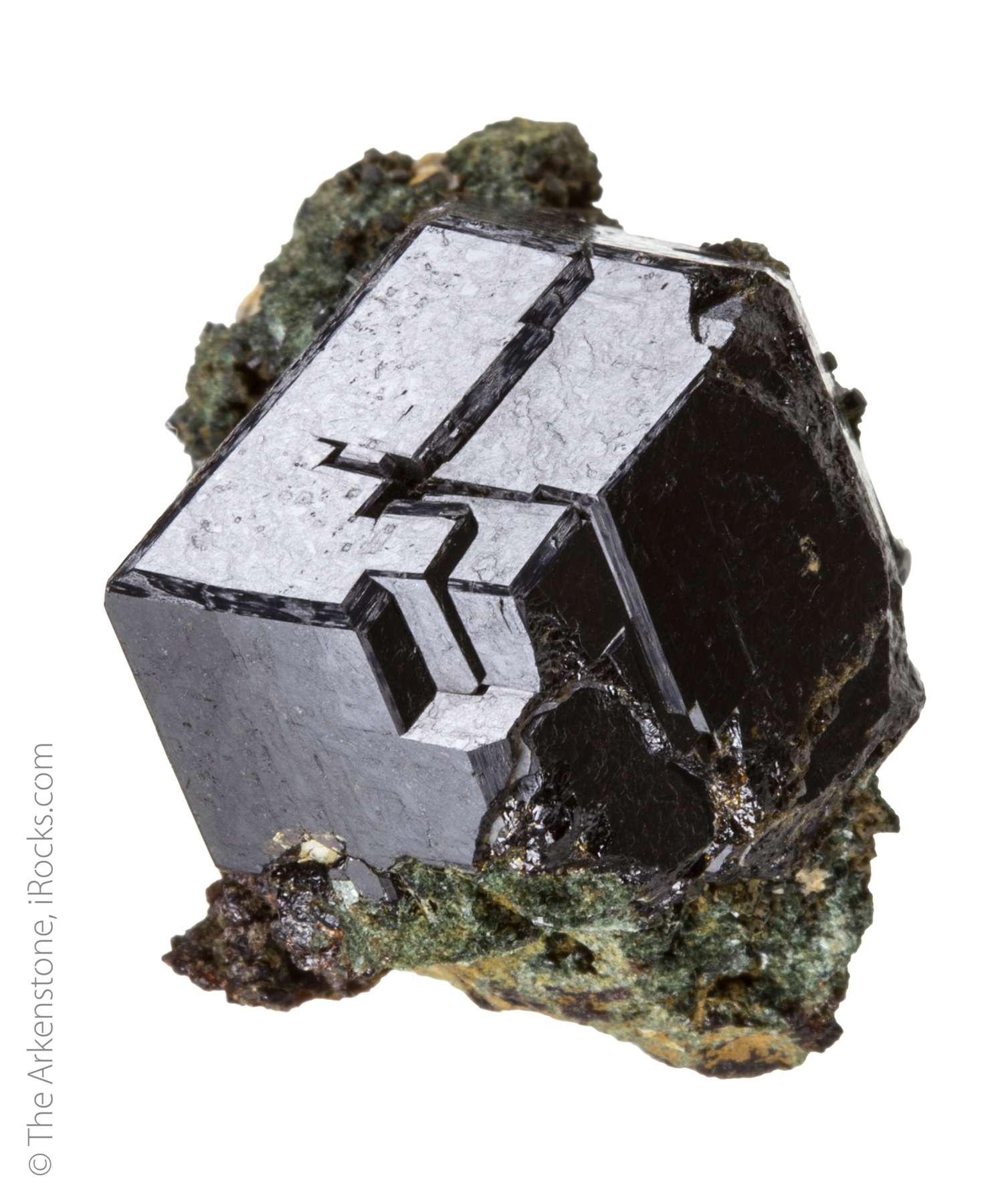 A large formed lustrous black melanite garnet crystal measuring 2 6 cm
