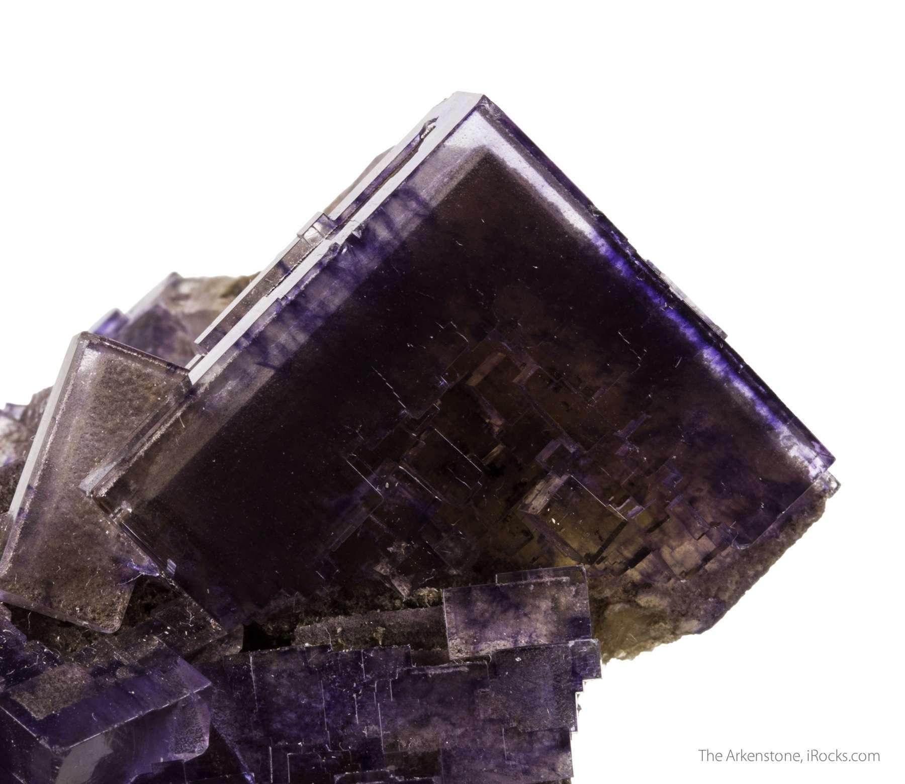 The fluorite crystals cluster exhibit opaque dark purple initiation