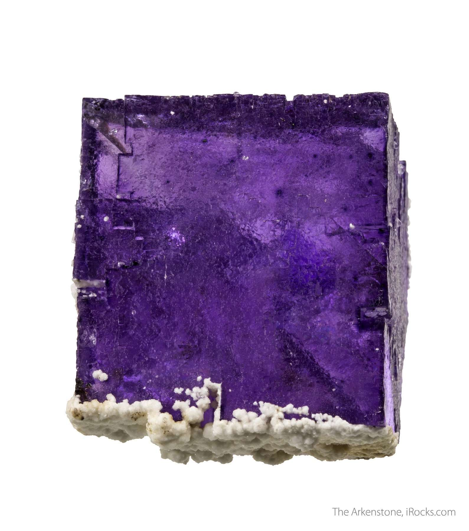 This lustrous gemmy crystal fluorite colored saturated purple hue